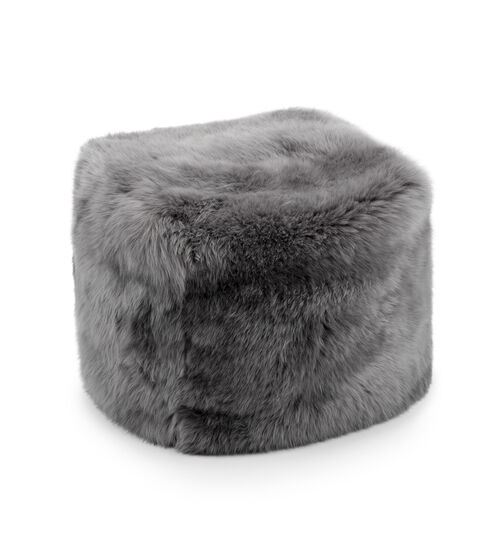UGG Pouf In Grey This sumptuous pouf is a must-have for any home. A transitional decor piece, it can be used as an ottoman, an extra seat, or even a side table. UGG Pouf In Grey
