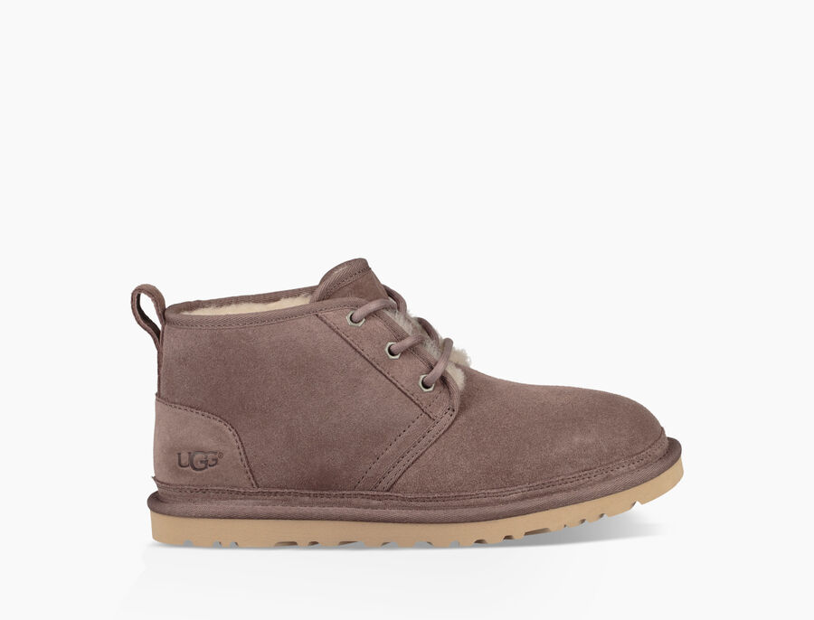 The most versatile of all Men's shoes, boots cover a full spectrum of wearing-occasions. Tailored chukka, Chelsea, and combat boots are apt for school, the office, or weekend trips year-round, while casual sheepskin and technical all-weather boots are crafted for leisure and performance in colder months.