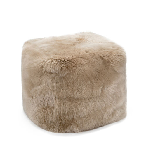 UGG Pouf In Brown This sumptuous pouf is a must-have for any home. A transitional decor piece, it can be used as an ottoman, an extra seat, or even a side table. UGG Pouf In Brown