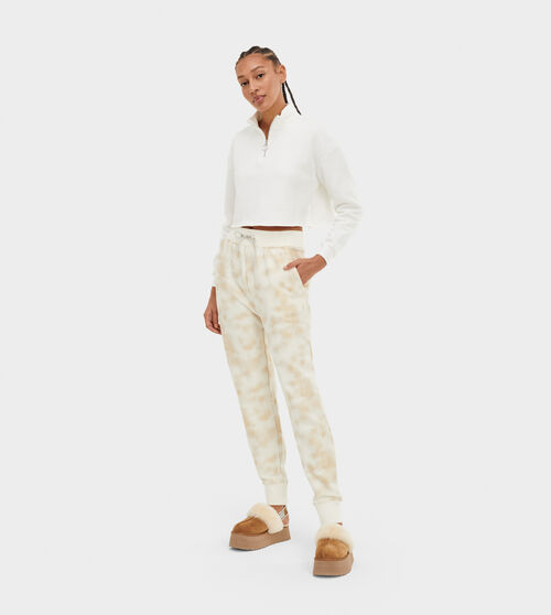 UGG Women's Ericka Metallic Relaxed Jogger Brushed Fleece, Size M Pants Made from 48% recycled cotton, our two-sided brushed fleece offers fluffy softness inside and a clean, sweatshirt-like finish on the outside. Adding this cozy and versatile material to a stylish, loungeworthy silhouette with all-over metallic print, our Ericka Relaxed Jogger features front pockets with velvet facing for a smooth feel, plus rib knit cuffs and an easy elasticized waistband. Perfect for sleep, errands, or just lounging around, you can't go wrong with the Ericka. UGG Women's Ericka Metallic Relaxed Jogger Brushed Fleece, Size M Pants