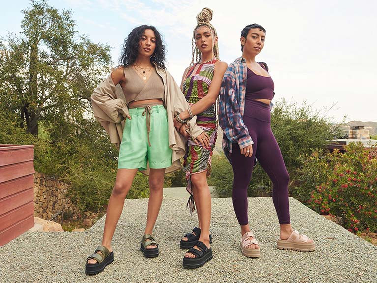 Three women in UGG sandals.