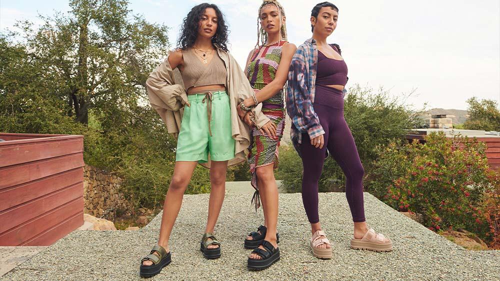 Three women in UGG sandals.