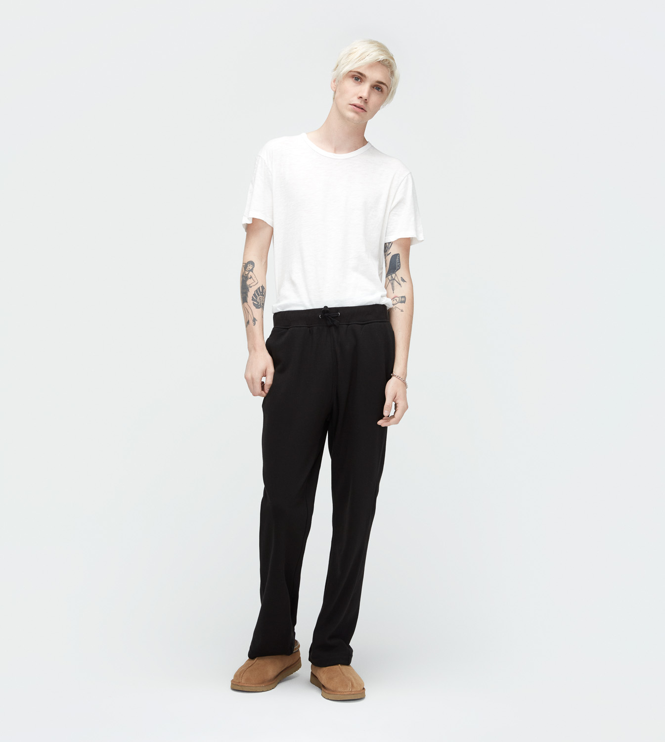 UGG Men's Wyatt Pant Cotton Blend Bottoms in Black, Size M These easy lounge pants are cast in our super-soft French terry with a relaxed fit. Wear for slow mornings at home or out to breakfast with sneakers and a tee. Lightweight Double-Knit Fleece: 92% Cotton, 8% Spandex with 100% Polyester Pile. Relaxed fit. Rib waistband with twill drawcord. Side pockets. 30.5  inseam (size M). UGG Men's Wyatt Pant Cotton Blend Bottoms in Black, Size M