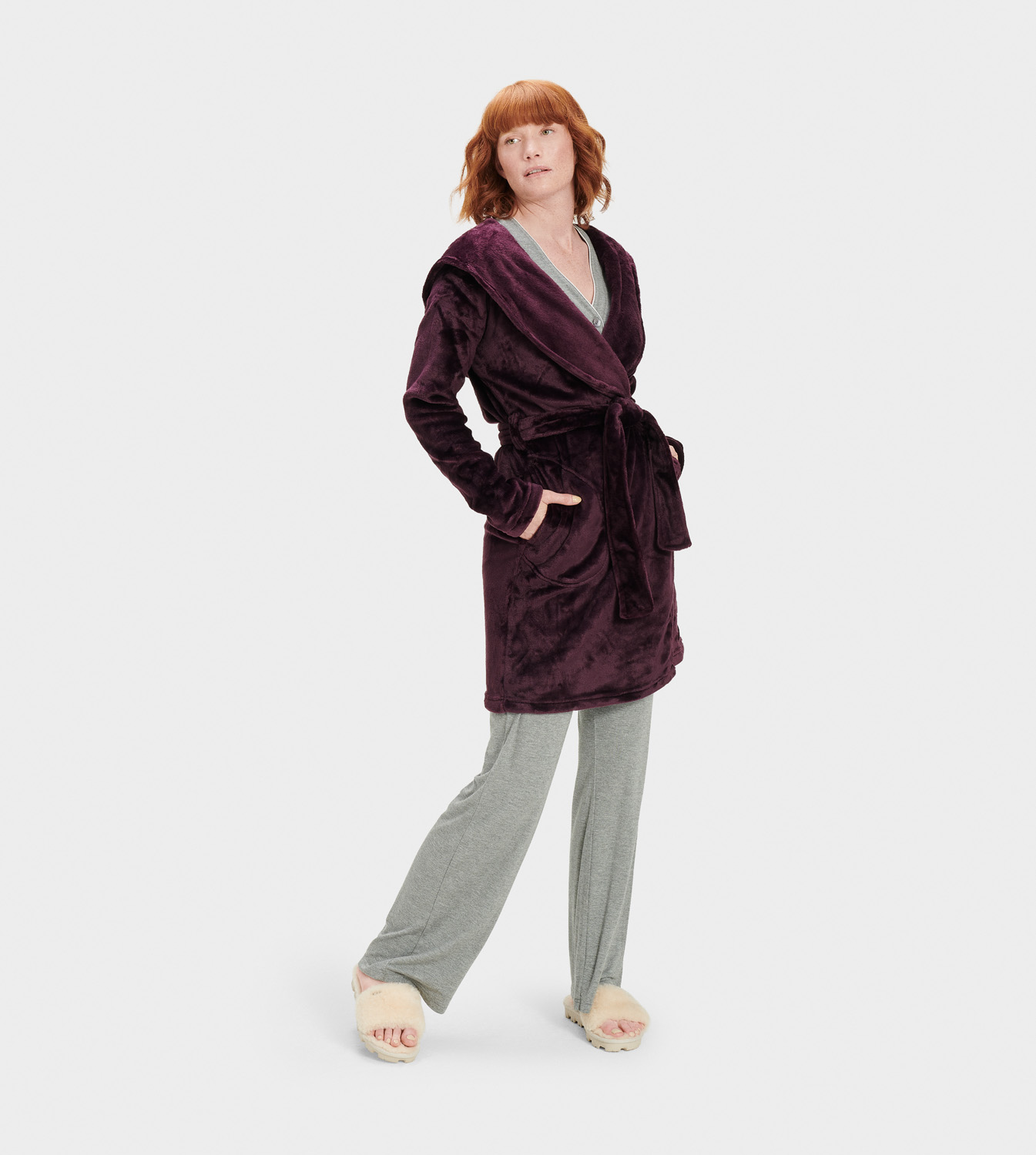 UGG Women's Miranda Fleece Robe Sleepwear in Red, Size M Made from a silky double-face fleece knit, this irresistibly soft robe has the power to turn a lazy day at home into a rejuvenating staycation. Double Face Fleece Knit - 100% Polyester. Hooded shawl collar robe. On-seam side pockets. Self belt. Straight hem. UGG woven flag label at hand pocket. 36  center back length [Size S]. UGG Women's Miranda Fleece Robe Sleepwear in Red, Size M
