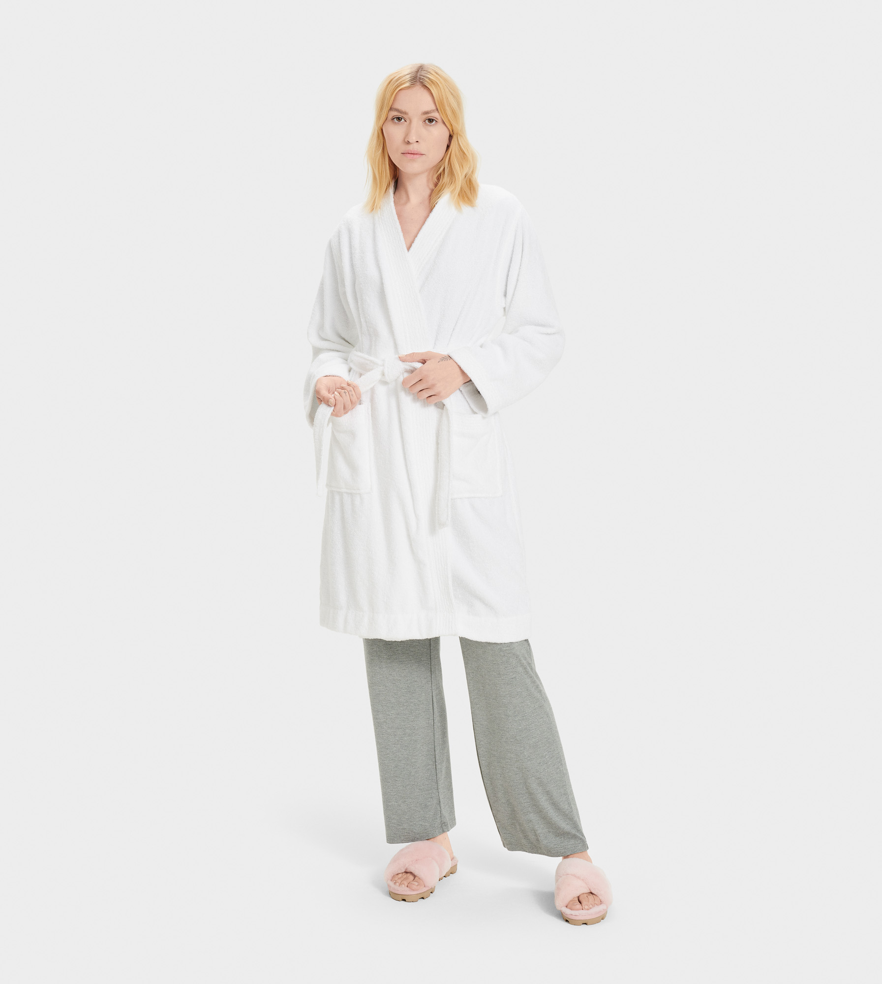UGG Women's Lorie Terry Robe Cotton Blend Sleepwear in White, Size M/L Made from a soft cotton terry knit, this cozy robe is perfect for relaxed weekend mornings. Best paired with fluffy slippers and an espresso. Double loop terry: 100% Cotton. Self-tie. Patch pockets. 39  center back length. UGG Women's Lorie Terry Robe Cotton Blend Sleepwear in White, Size M/L