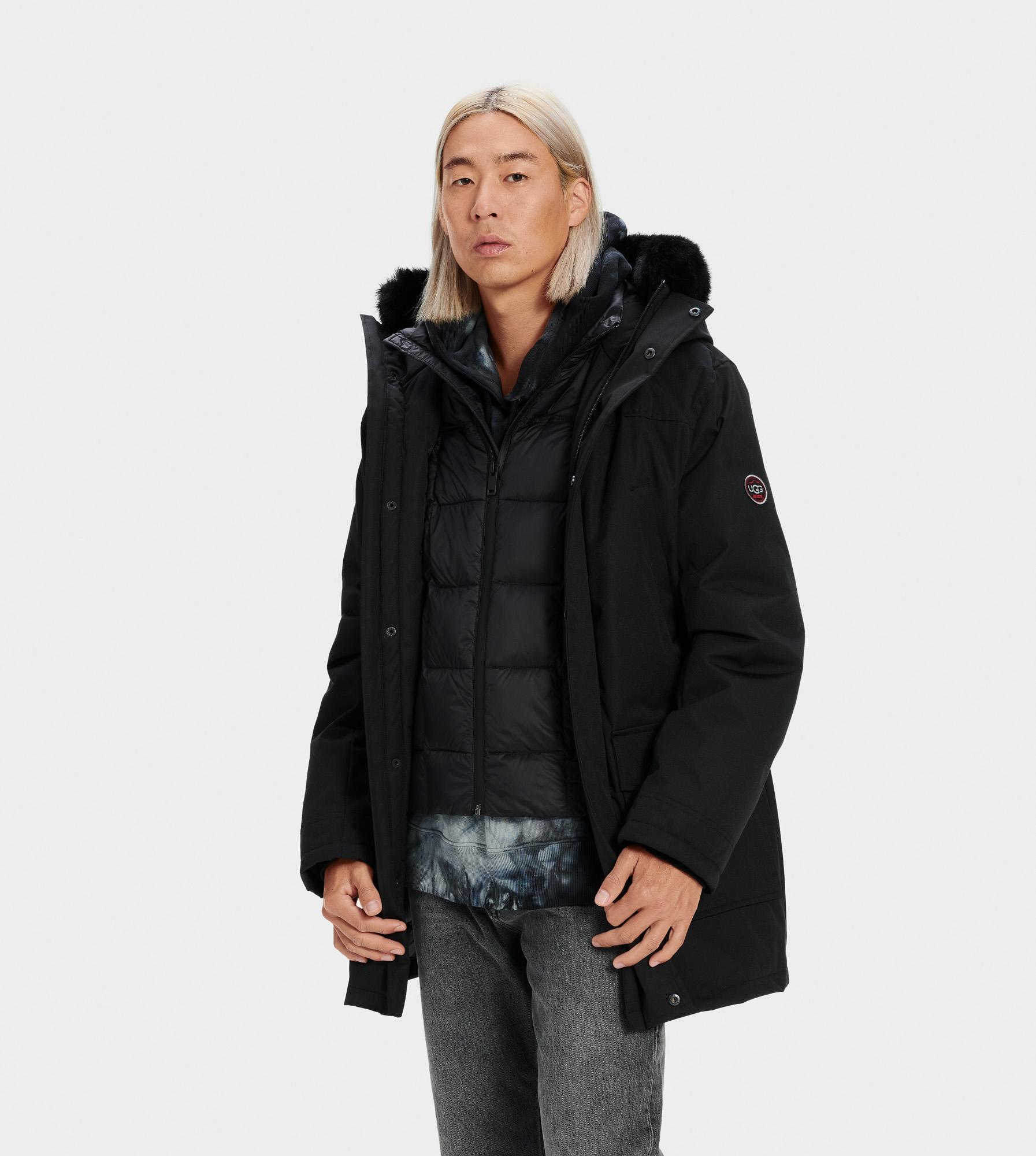 UGG Men's Butte Parka Nylon in Black, Size S Our most serious men's cold-weather coat, the Butte parka is made for temperatures as low as -31.4C (-24.52 F). This down-filled jacket features a water-resistant shell to keep you warm and dry. For added protection from the elements, it includes a detachable down vest, removable fur trim hood, and fleece-lined pockets. Down-filled, waterproof tech parka with detachable nylon down vest. Waterproof Woven Shell: 85% Polyester, 15% Cotton. AATCC127 Waterproof tested. Temperature rated at -31.4° Celsius. Fleece pocket linings. Removable Toscana fur hood trim. Internal cell phone pocket. 34  center back length. Removable down vest liner: 25  center back length. Dry clean only. UGG Men's Butte Parka Nylon in Black, Size S