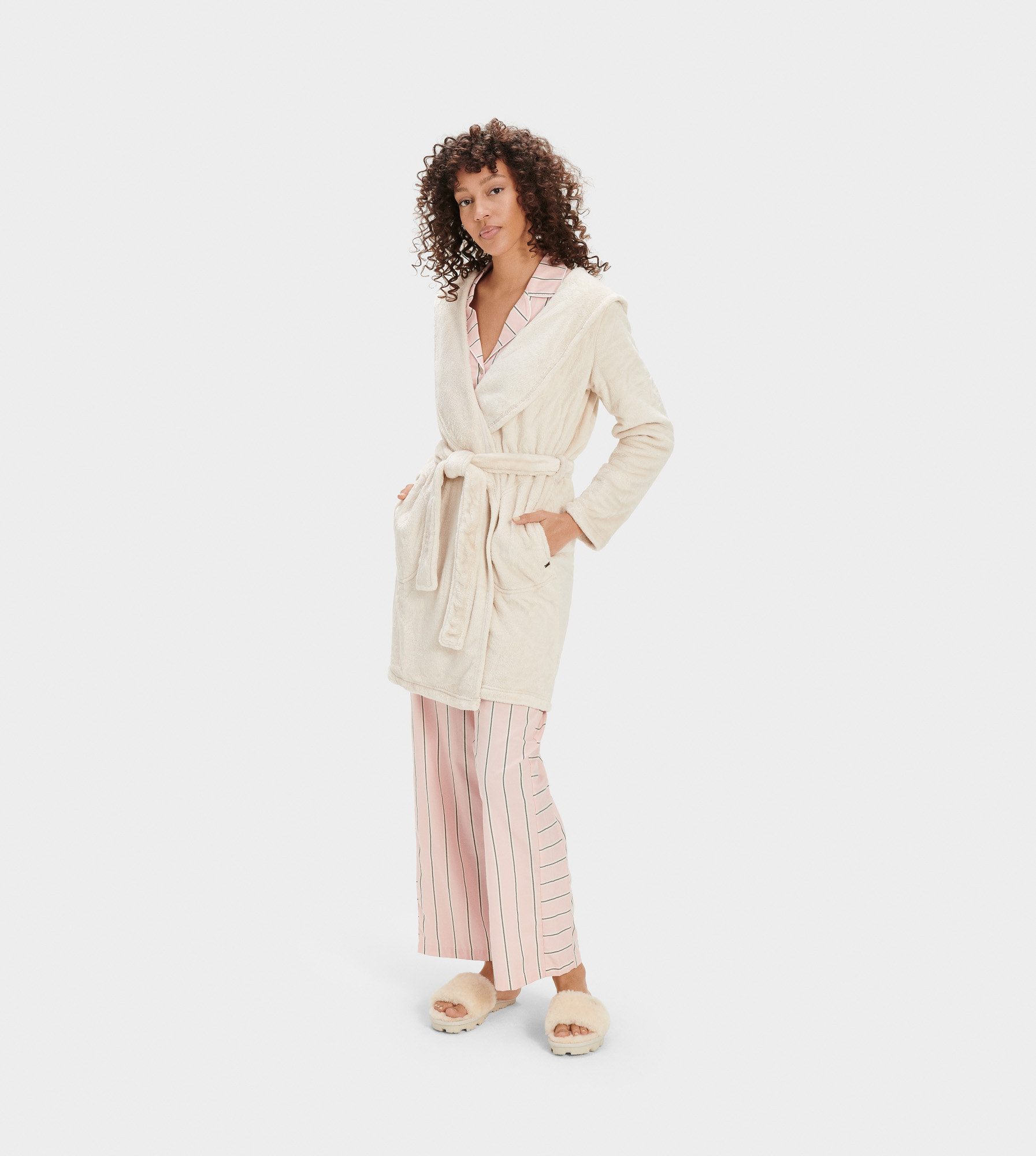 UGG Women's Miranda Fleece Robe Sleepwear in White, Size L Made from a silky double-face fleece knit, this irresistibly soft robe has the power to turn a lazy day at home into a rejuvenating staycation. Double Face Fleece Knit - 100% Polyester. Hooded shawl collar robe. On-seam side pockets. Self belt. Straight hem. UGG woven flag label at hand pocket. 36  center back length [Size S]. UGG Women's Miranda Fleece Robe Sleepwear in White, Size L