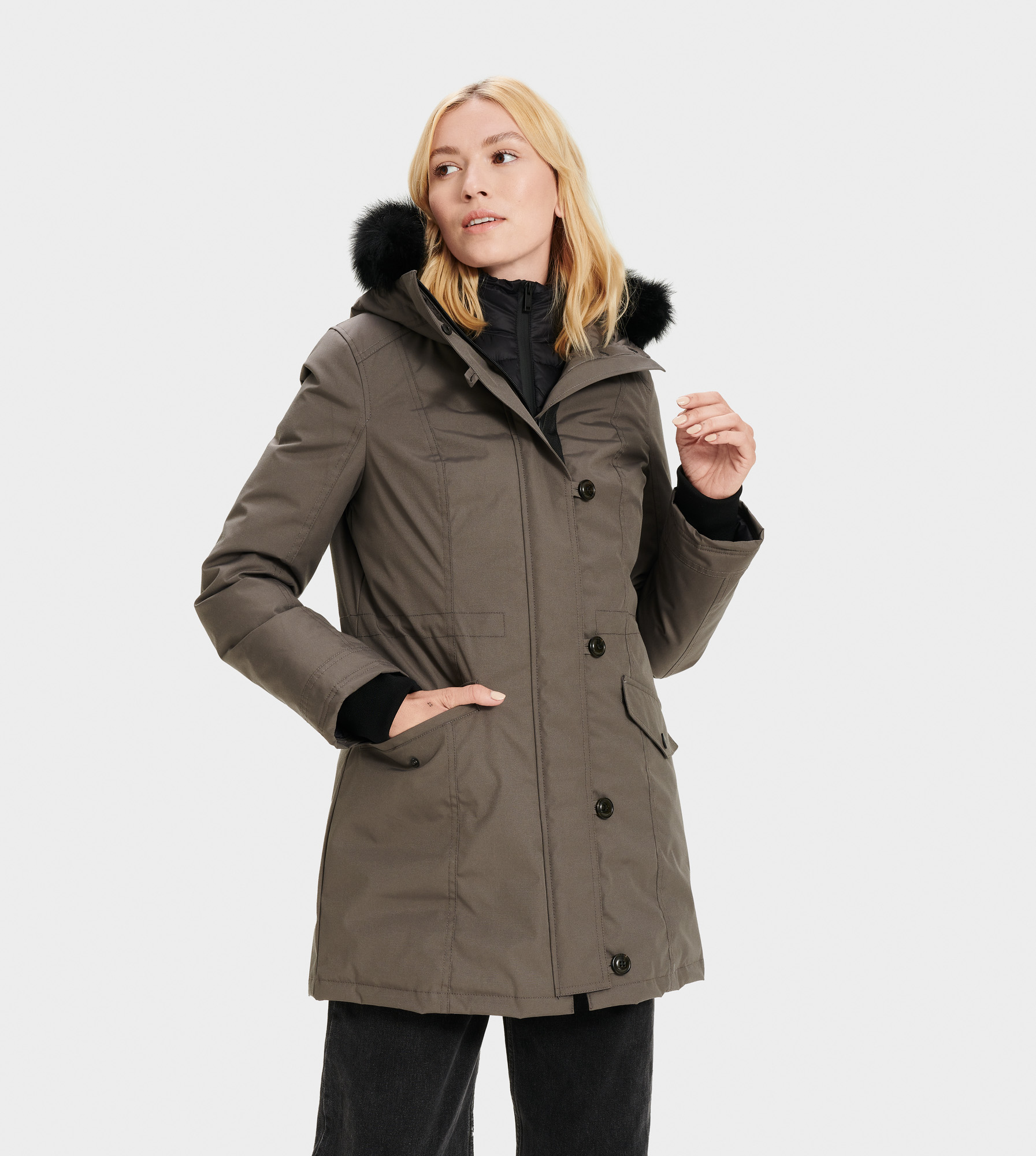 UGG Women's Adirondack Parka Sheepskin in Dark Grey, Size L Our most serious cold-weather coat, the Adirondack parka is made for temperatures as low as -31.4C (-24.52 F). Incorporating waterproof material and warming down, it also features a detachable vest that can be worn with the jacket, or by itself. With silky Toscana sheepskin trim and a cinched waist, you can stay stylish in any weather. Down-filled, waterproof tech parka with detachable nylon down vest. Waterproof Woven Shell: 85% Polyester, 15% Cotton. AATCC127 Waterproof tested. Temperature rated at -31.4° Celsius. Fleece pocket linings. Removable Toscana fur hood trim. Internal cell phone pocket. 32  center back length. Removable down vest liner: 24  center back length. Dry clean only. UGG Women's Adirondack Parka Sheepskin in Dark Grey, Size L