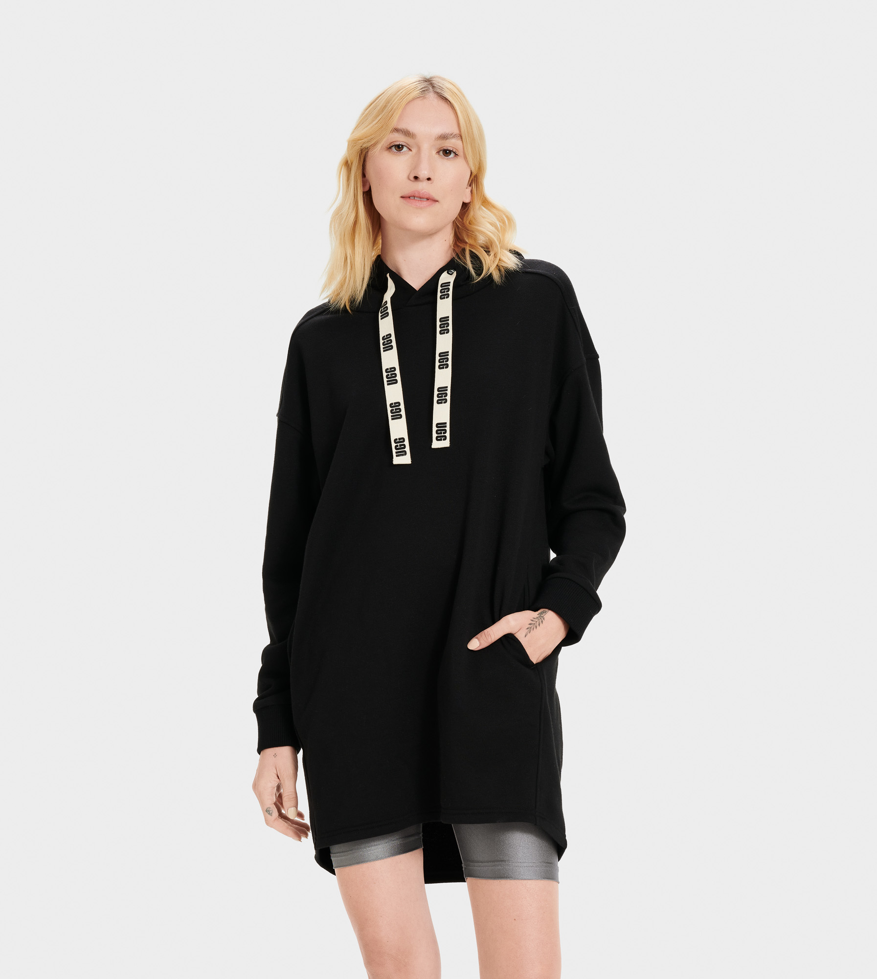 UGG Women's Lucille Hoodie Dress Cotton Blend Hoodies & Sweatshirts in Black, Size XS Made from soft french terry, this pullover hoodie dress features ribbed cuffs and side pockets, striking the perfect balance between cool and casual. Wear yours with platform sneakers for a fun, sporty look. Brushed French Terry - 80% Polyester/20% Cotton. Pullover hoodie dress. Ribbed cuff. Side pockets. Cotton Drawcords with printed UGG logo on one side. 33 7/8  Center back length [Size S]. UGG Women's Lucille Hoodie Dress Cotton Blend Hoodies & Sweatshirts in Black, Size XS