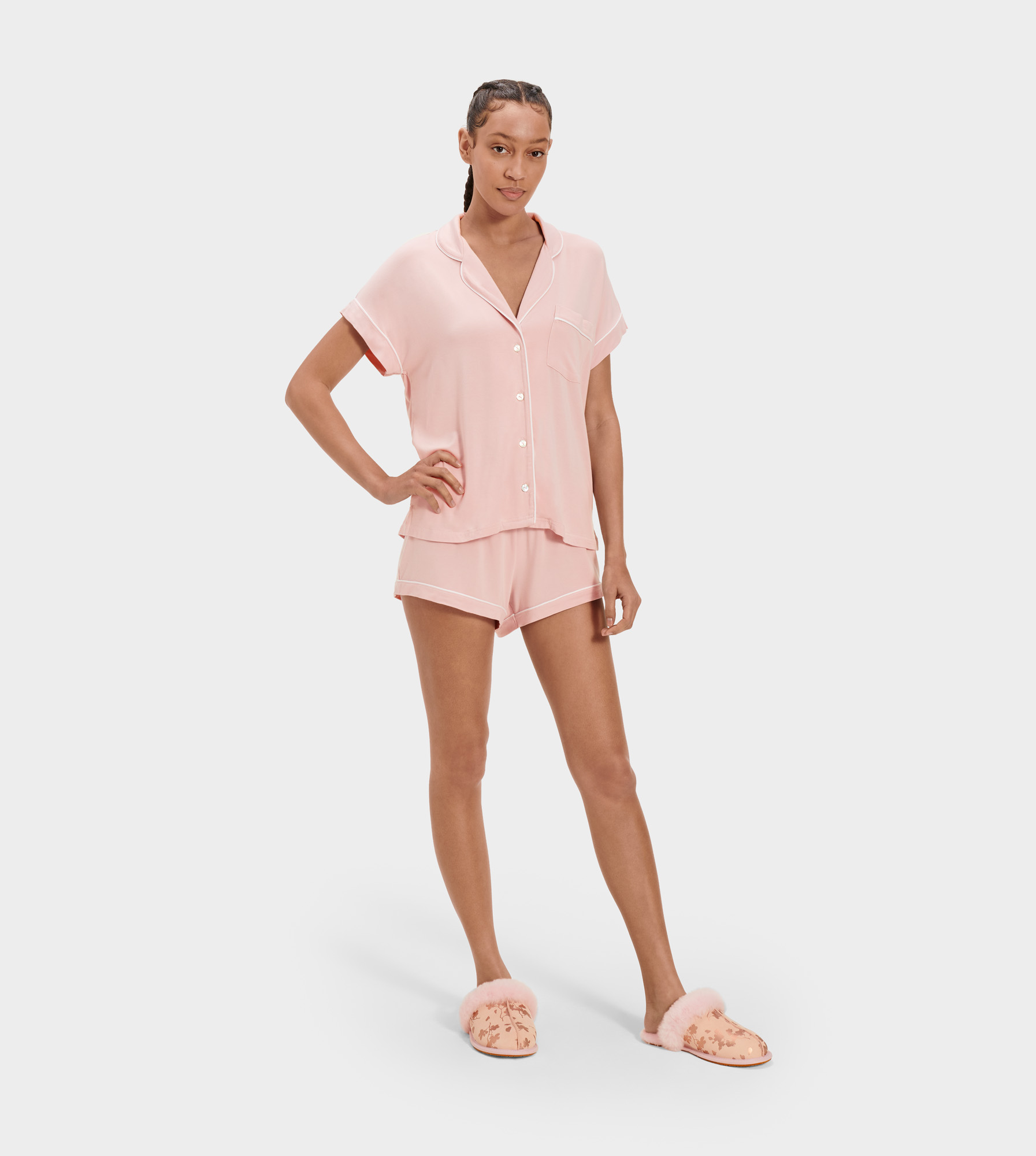 UGG Women's Amelia Set Knit Jersey Sleepwear in Mauve, Size L Crafted from lightweight jersey knit, this striped update to our Amelia sleepwear set is perfect for summer. Pair with one of our fluffy slippers for an extra cozy feel. Lightweight Jersey Knit - 95% Modal/5% Elastane. Sleepwear set. Top: Notch collared short sleeve shirt with button front. Contrast color self piping. Chest pocket. UGG logo shell buttons. 23 1/8  center back length [Size S]. Bottom: Matching sleep short with elastic waistband. 2 1/2  inseam [Size S]. UGG Women's Amelia Set Knit Jersey Sleepwear in Mauve, Size L