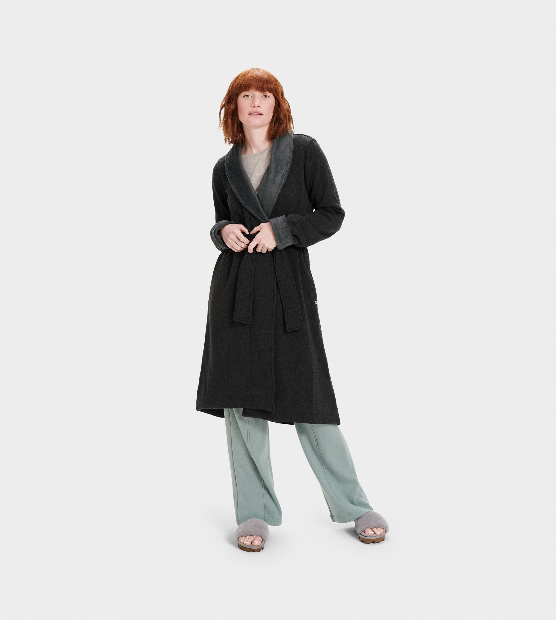 UGG Women's Duffield II Fleece Sleepwear in Black, Size M Our best-selling robe, the Duffield is crafted from soft fleece, so it feels like wrapping yourself in a blanket. Pair with our fluffy slippers and pretend it's the weekend. Double knit fleece: 94% Cotton, 6% Elastane, 100% Polyester pile. Self belt. On-seam side pockets. 43.5  center back length. UGG Women's Duffield II Fleece Sleepwear in Black, Size M