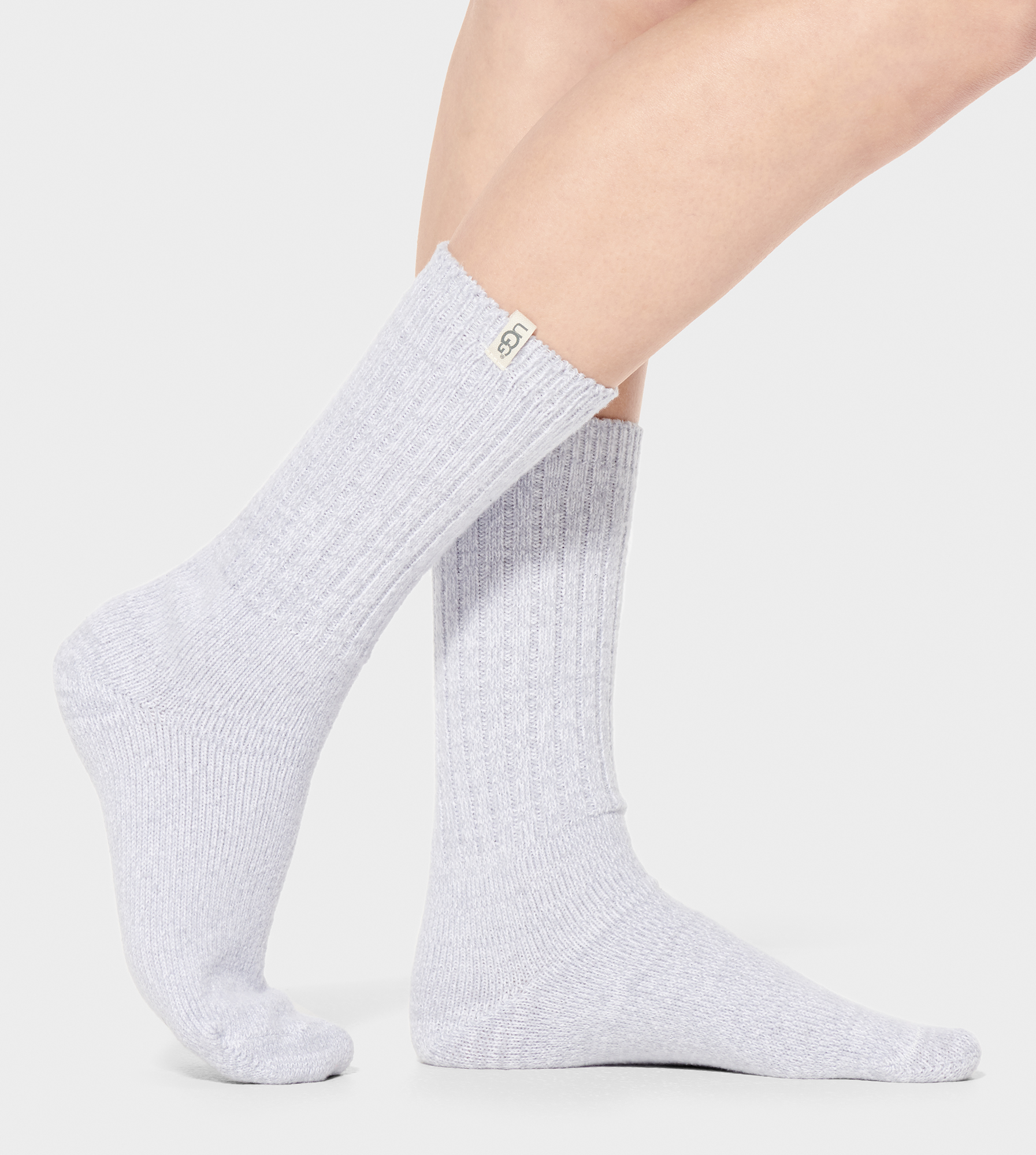 UGG Women's Rib Knit Slouchy Crew Sock Polyester Socks in Icelandic Blue Just slouchy enough, these ultra-soft knit socks are a favorite. Wear around the house, or peeking out from an ankle boot. 99% Polyester, 1% Spandex. UGG Women's Rib Knit Slouchy Crew Sock Polyester Socks in Icelandic Blue