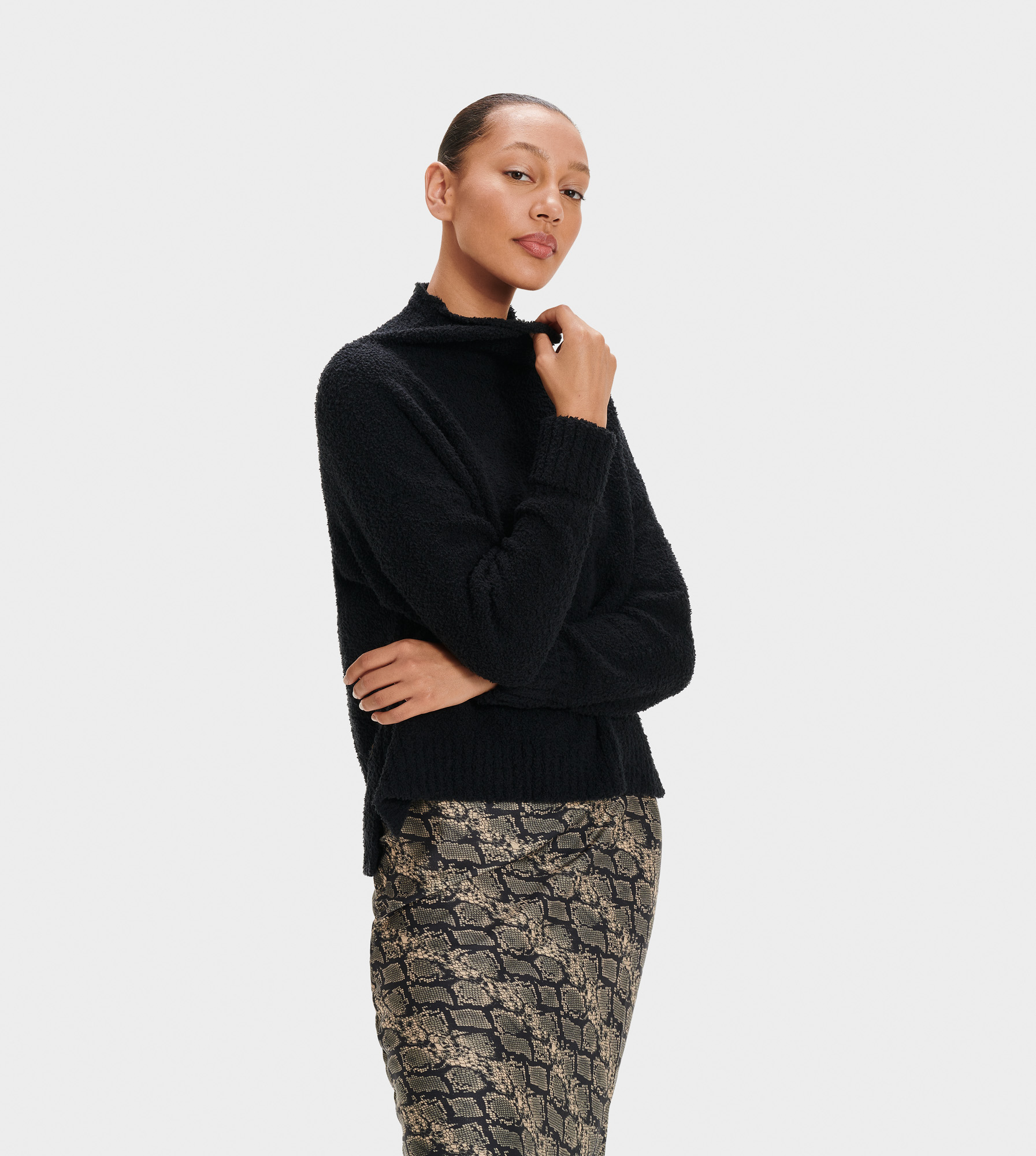 UGG Women's Sage Sweater Polyester Tops in Black, Size L A cozy turtleneck with an understated aesthetic, our Sage sweater is a staple piece for any winter wardrobe. Pair it with elevated skirts and trousers for a night on the town, or wear around the house with your favorite sweatpants. 78% Polyester, 22% Nylon. Drop shoulder. 26  center back length. UGG Women's Sage Sweater Polyester Tops in Black, Size L