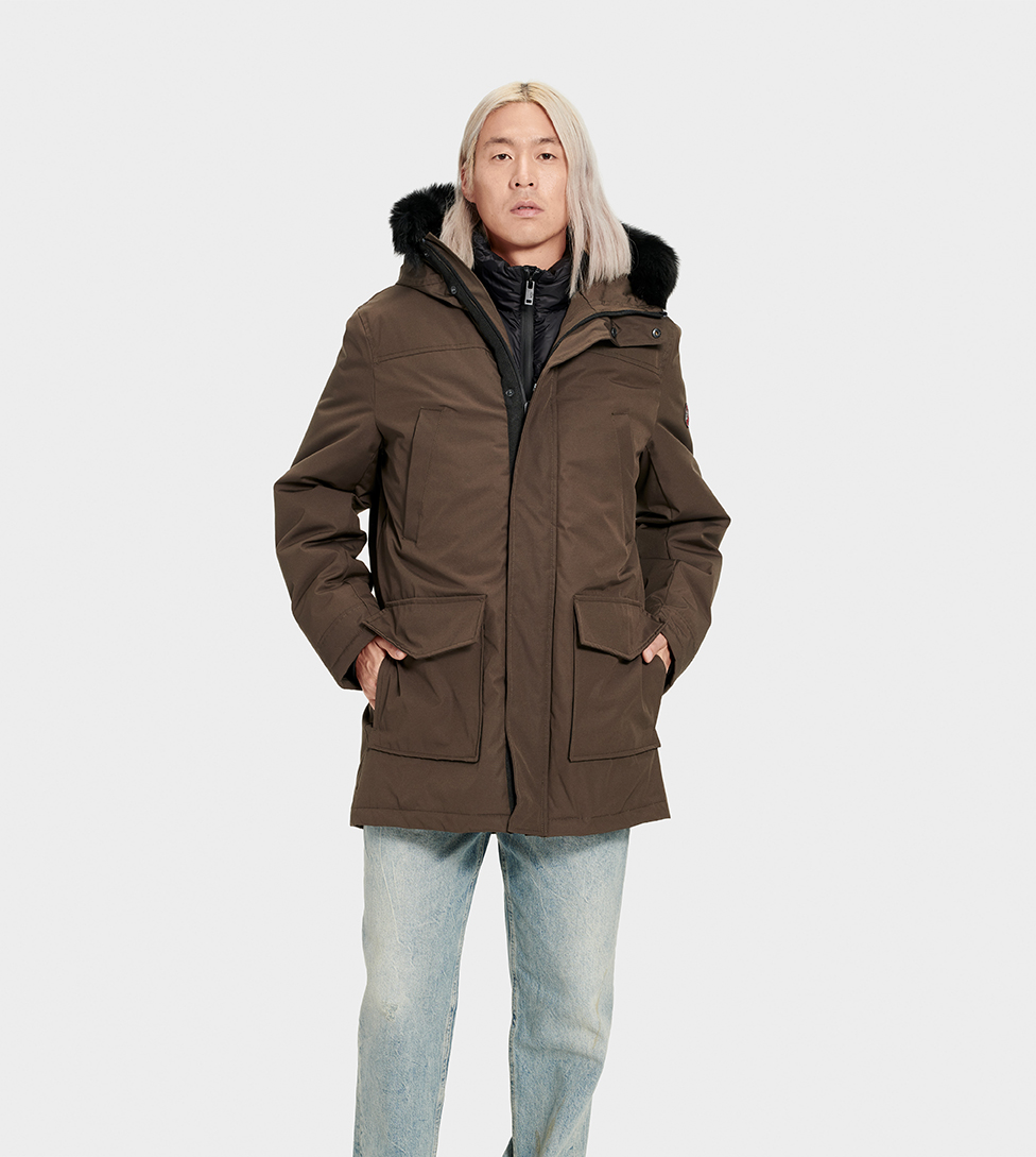 UGG Men's Butte Parka Nylon in Brown, Size XS Our most serious men's cold-weather coat, the Butte parka is made for temperatures as low as -31.4C (-24.52 F). This down-filled jacket features a water-resistant shell to keep you warm and dry. For added protection from the elements, it includes a detachable down vest, removable fur trim hood, and fleece-lined pockets. Down-filled, waterproof tech parka with detachable nylon down vest. Waterproof Woven Shell: 85% Polyester, 15% Cotton. AATCC127 Waterproof tested. Temperature rated at -31.4° Celsius. Fleece pocket linings. Removable Toscana fur hood trim. Internal cell phone pocket. 34  center back length. Removable down vest liner: 25  center back length. Dry clean only. UGG Men's Butte Parka Nylon in Brown, Size XS