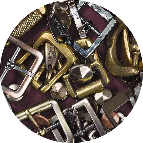 image of belt buckles, buttons, and zippers