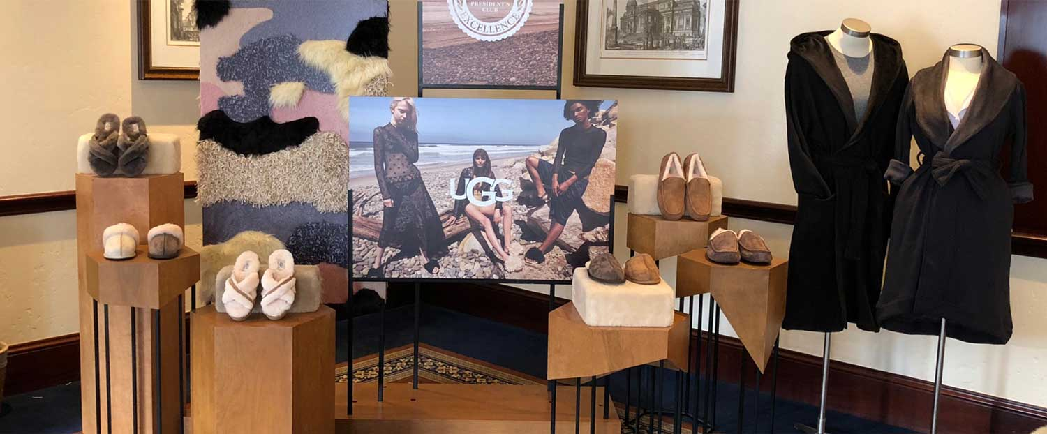 A display off UGG merchendise with a campaign photo stand in the middle.
