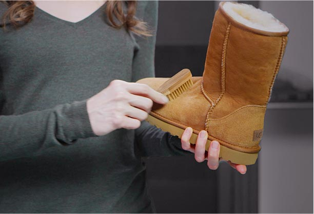 Woman brushing an UGG Classic