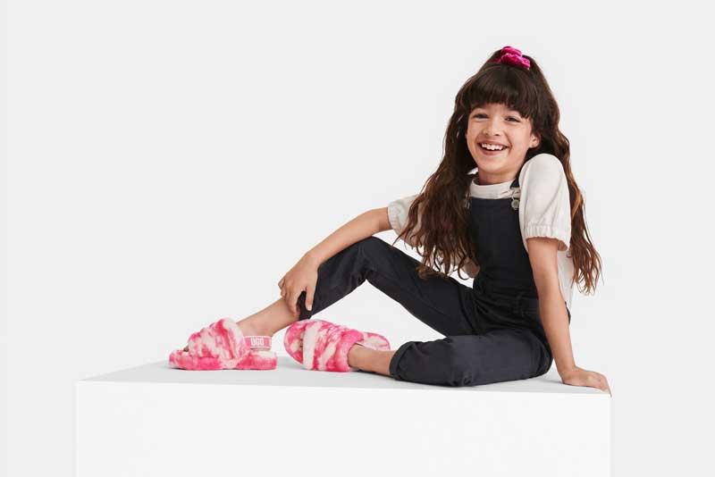 Child model in pink zebra Fluff Yeah slides.