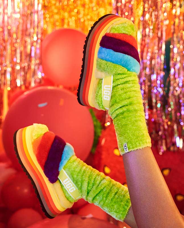Model with feet up in the air wearing the Disco Stripes.