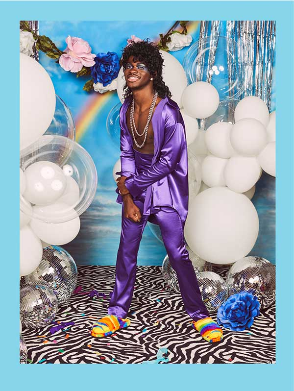 Lil Nas X in purple clothes wearing the Pride Fluff You.