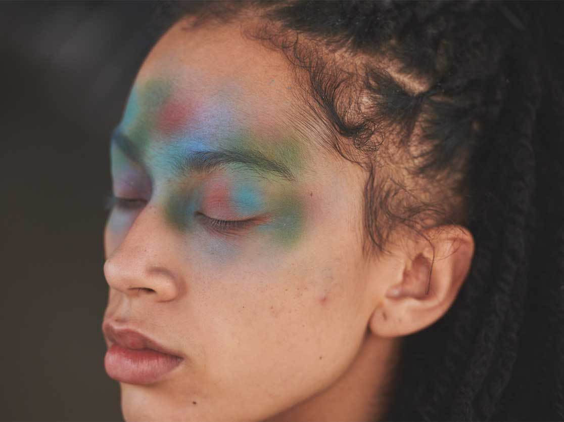 Woman's face with colorful makeup.