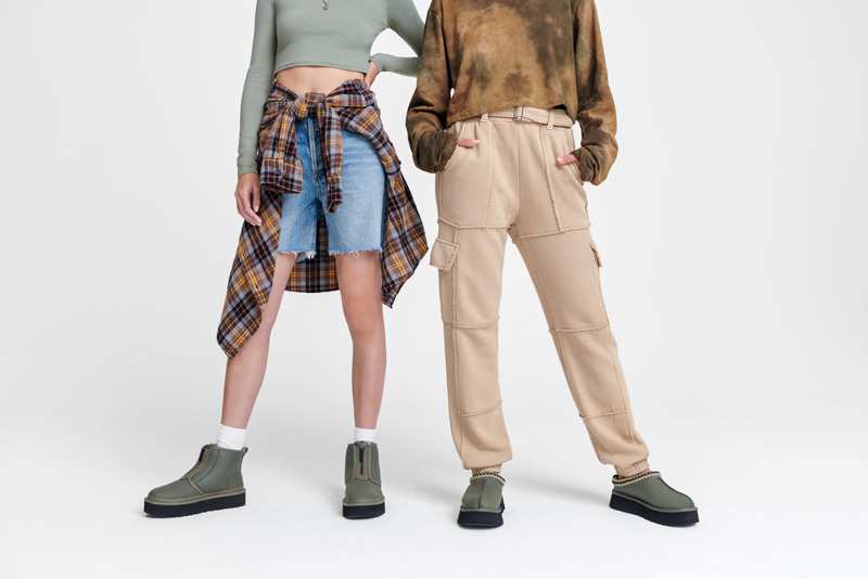 Two people wearing new UGG shoes.