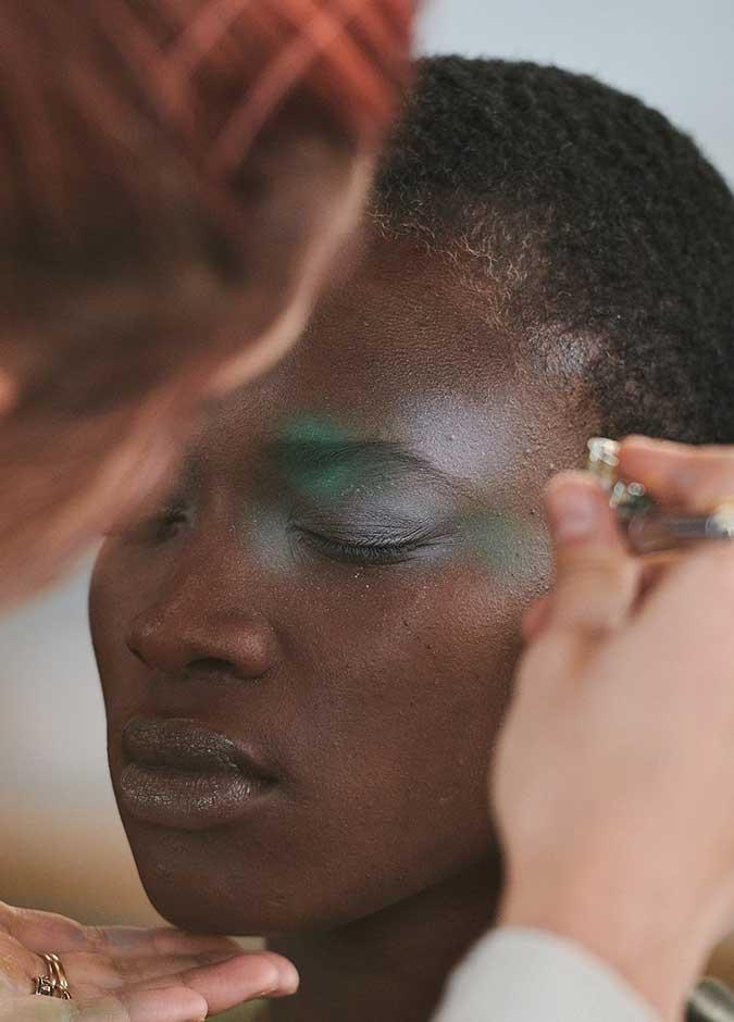 Model having makeup applied.