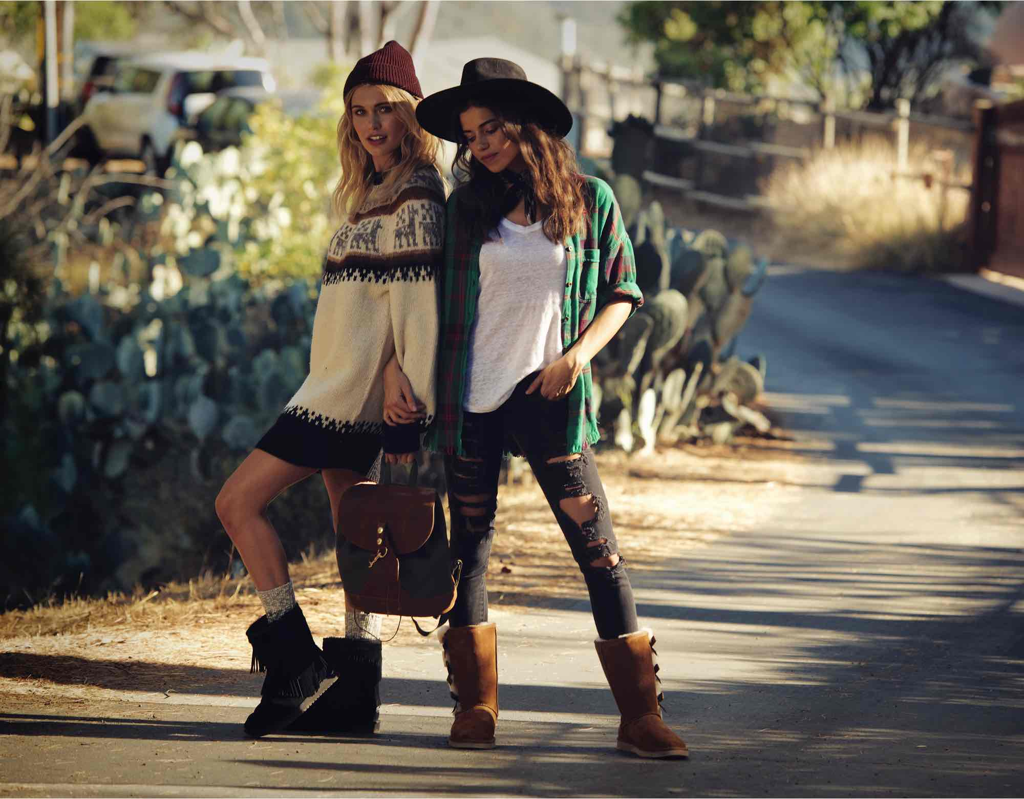 Two women in casual fall and winter attire in warm Koolaburra boots.