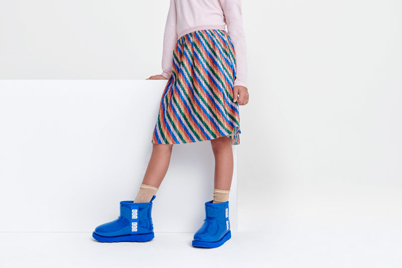 A child wearing UGG boots.
