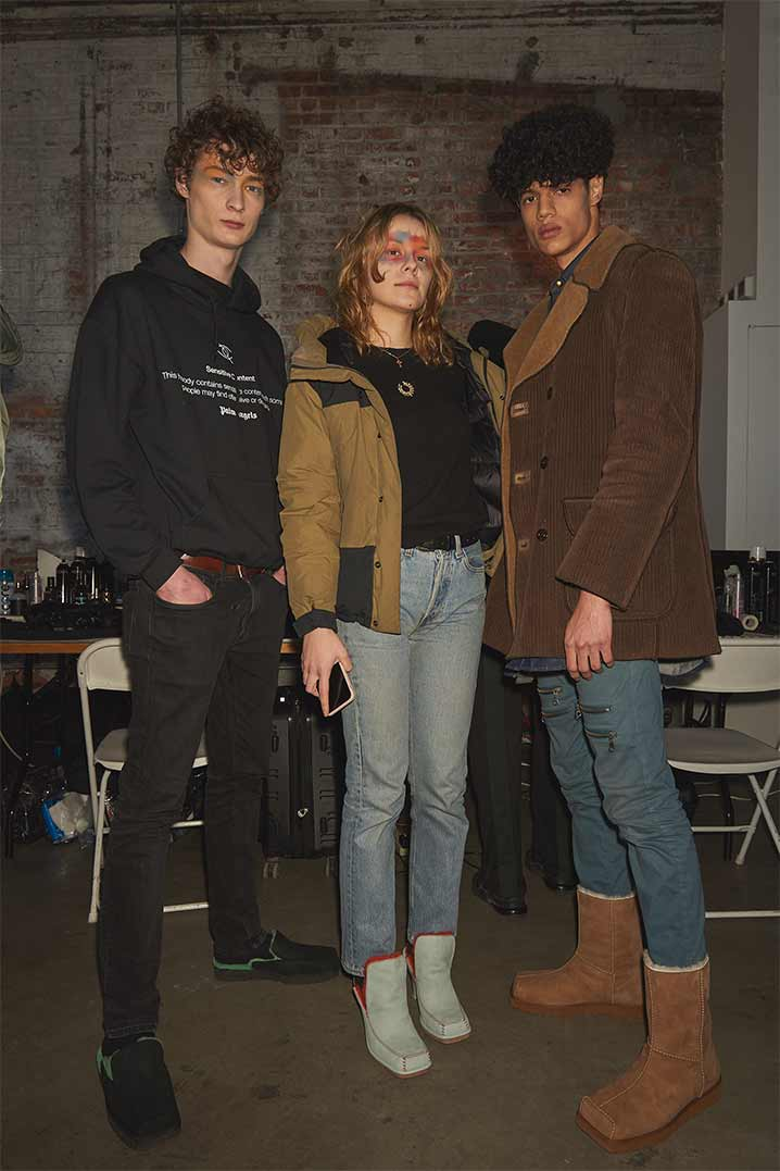 Two men and one woman wearing Eckhuas Latta and UGG collaboration shoes.
