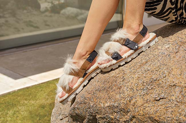 View of woman's feet wearing the Fluff Punk Slingback.