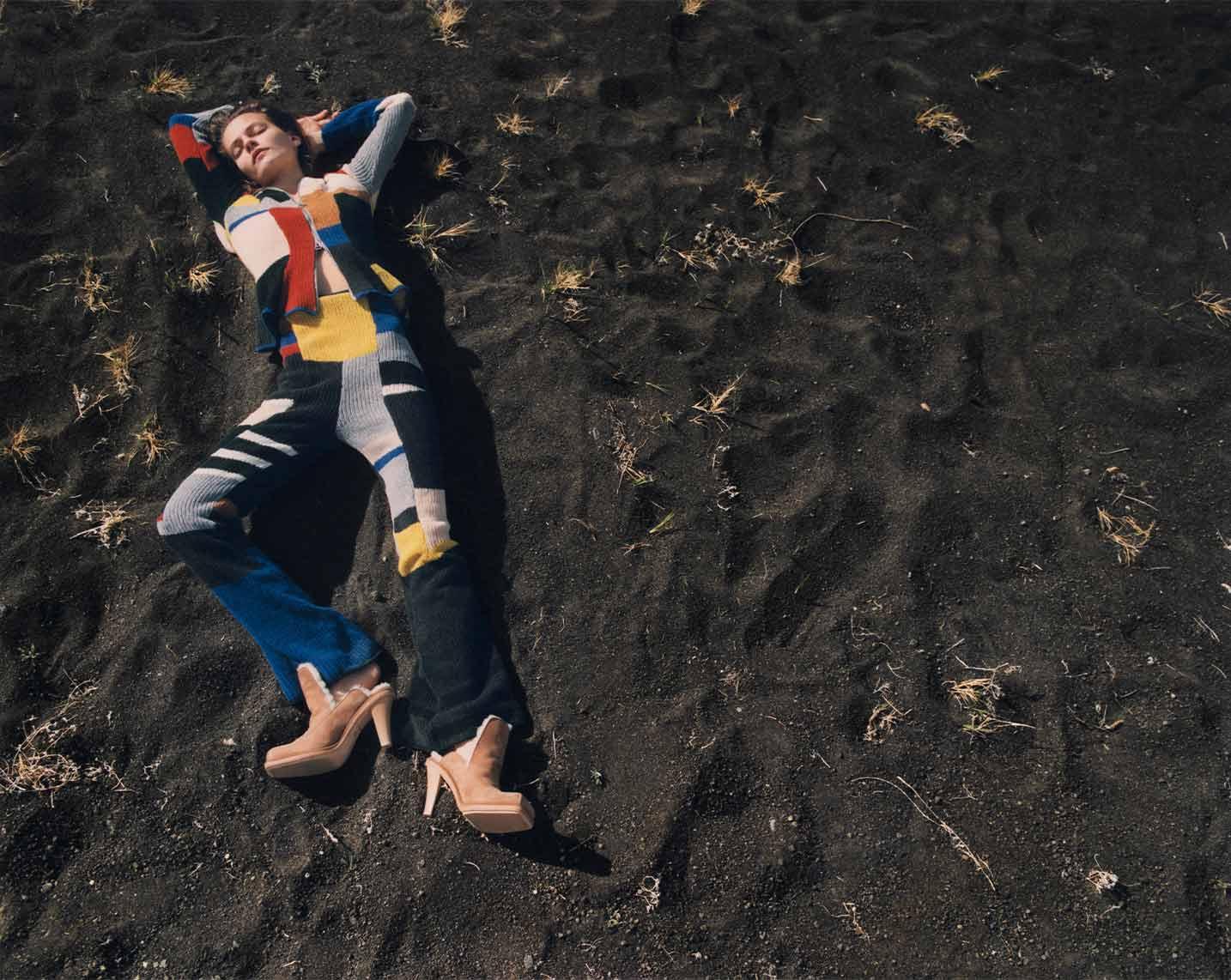 Woman lying on ground wearing Eckhaus Latta Chestnut heels.