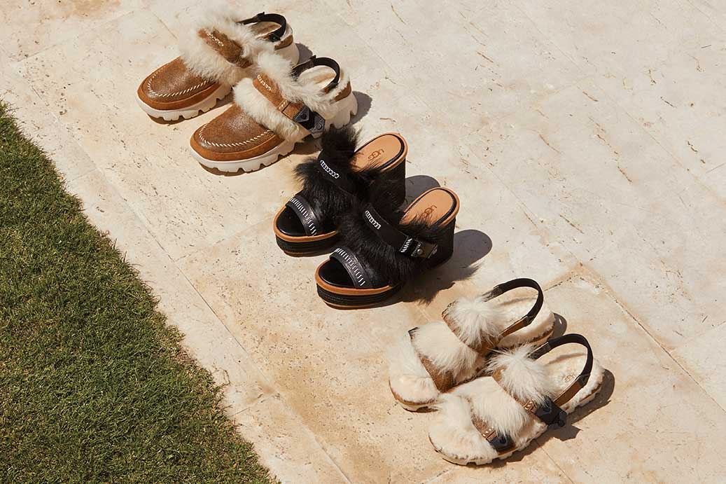 Fashion Baby Collection shoes in a line near grass.