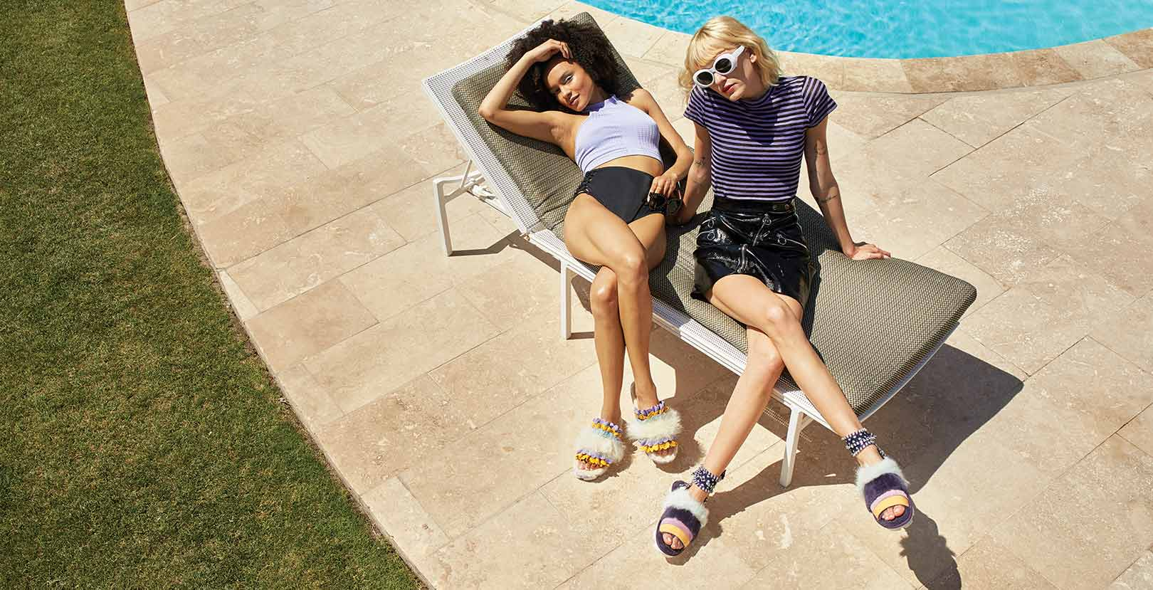 Two women wearing new desert dream sandals from the collection.