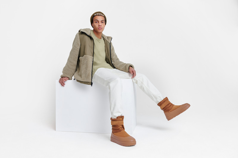 Person wearing winter UGG boots.