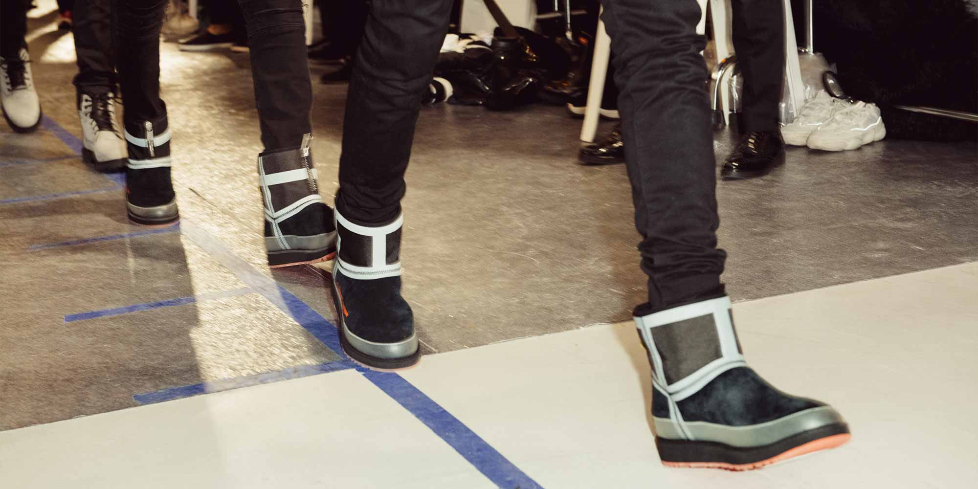 Runway models wearing Heron Preston + UGG collab.