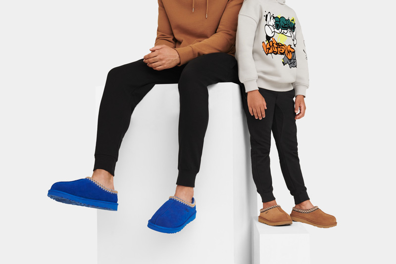 Closeup of an adult and child wearing UGG shoes.