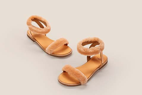 5579e4fb66 Orange sandals with fur straps. Shop Ugg Exclusives