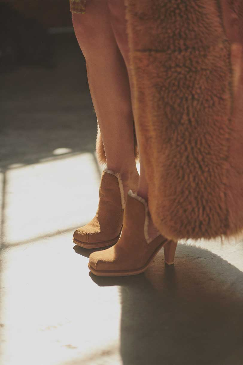 Eckhaus Latta and UGG collaboration shoes on model.