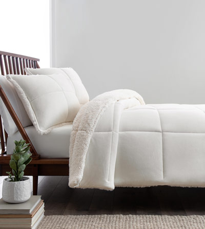 A snowy white bed linen set.