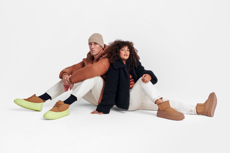 Two people wearing winter gear and UGG boots.