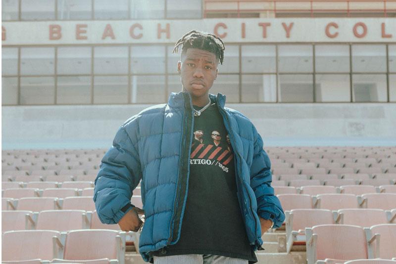 Collegiate model in men's UGG jacket.