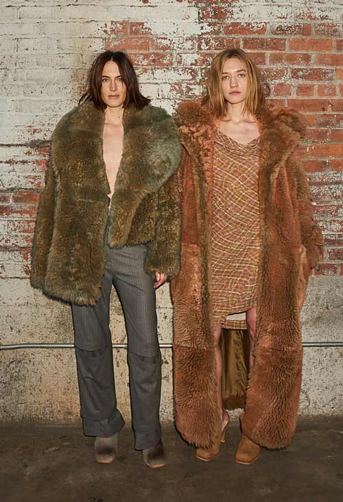 Two women wearing Eckhuas Latta and UGG collabortion shoes.